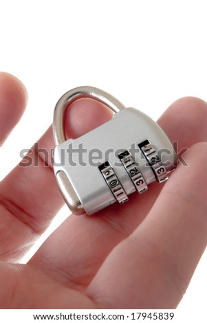 Code lock in hand on a white background