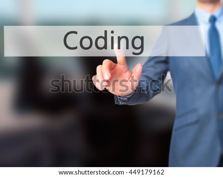 Coding - Businessman click on virtual touchscreen. Business and IT concept. Stock Photo