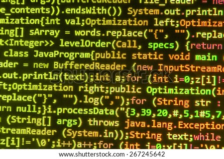 Coding programming background. Source code of software on monitor screen.  Shallow depth of field effect.  Green, orange, yellow color. - stock photo