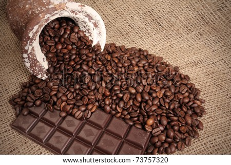 coffe beans on jute background with chocolate - stock photo