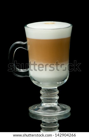 coffe latte cup on the black background - stock photo