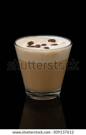 coffe latte cup on the black whiht coffe beans - stock photo