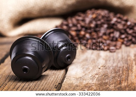 Coffe pods on wooden table - stock photo