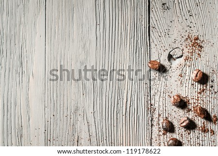 Coffe seed and wooden table background - stock photo