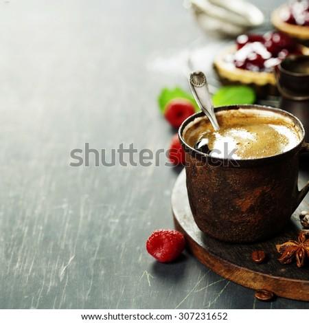 Coffe with Fruit dessert on dark background - stock photo