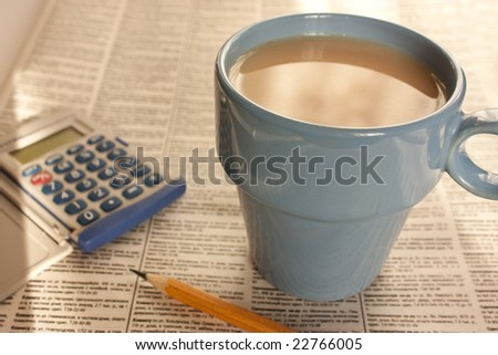 Coffee against the newspaper - stock photo