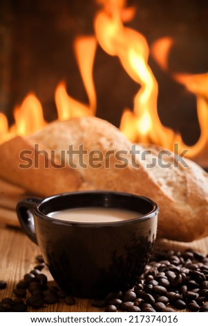 Coffee and bread  on the wooden table