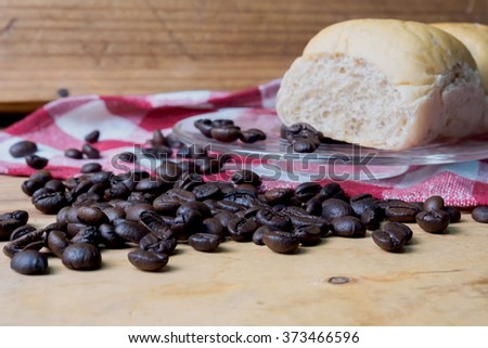 Coffee and bread wooden background