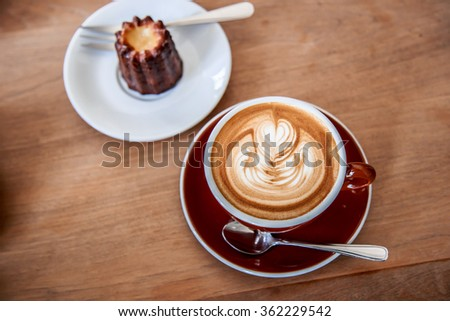 Coffee and cake in cafe - stock photo