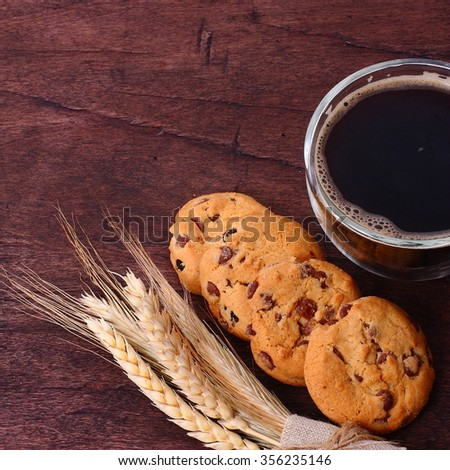 Coffee and cake on brown wooden table background. - stock photo