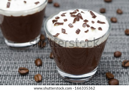 coffee and chocolate mousse with whipped cream, horizontal close-up - stock photo