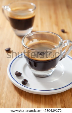 Coffee and coffee bean on wooden background, Coffee Espresso.   - stock photo