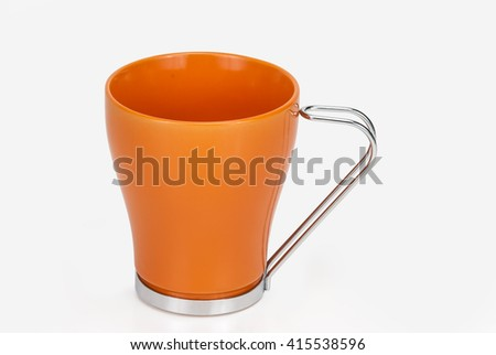 coffee and orange ceramic cup to drink both tea. - stock photo