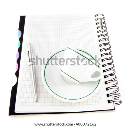 Coffee and pen on notebook isolated - stock photo