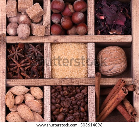 Coffee and spices in a wooden printers box.