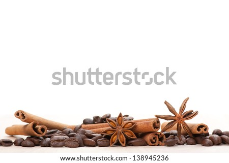Coffee and star anise on white - stock photo