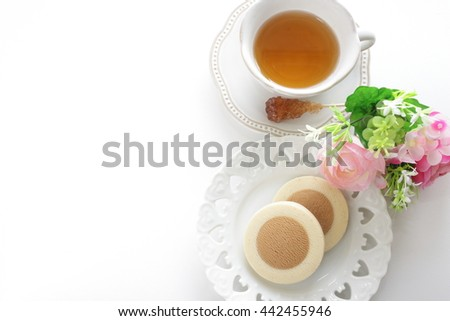 coffee and vanilla cookie with english tea - stock photo