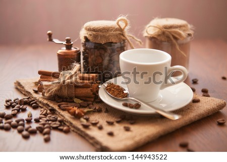 Coffee background with coffee beans and white cup - stock photo
