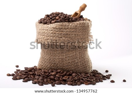 Coffee bag - coffee beans in canvas coffee sack isolated on white background - stock photo