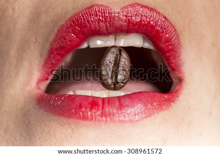 coffee bean between teeth with red lips