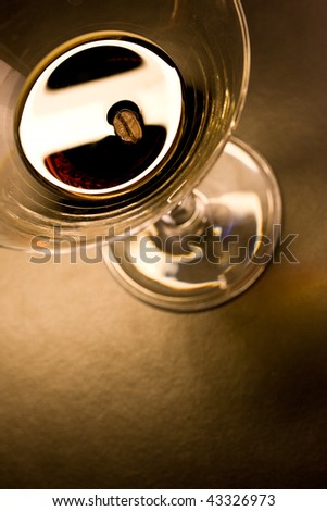 Coffee  bean in a martini glass filled with alcoholic coffee liquor - stock photo
