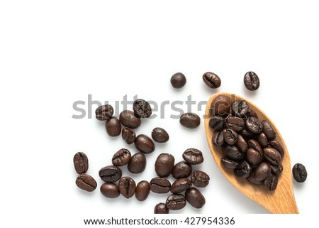 coffee bean in a wooden spoon on a white background. - stock photo