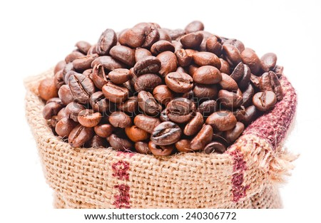 Coffee bean jute sack on isolated white background - stock photo