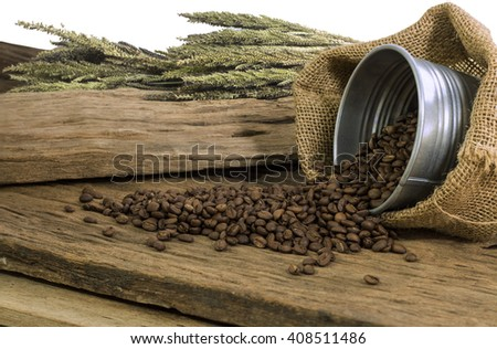 Coffee bean on board. Background is Green flowers.
