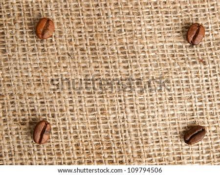Coffee bean on jute background. - stock photo