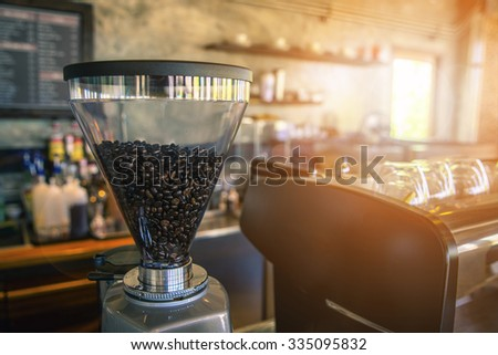 Coffee bean on the  brewing coffee machine in the shop - stock photo