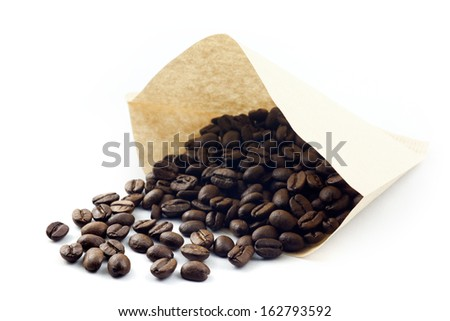 coffee bean with filter paper - stock photo