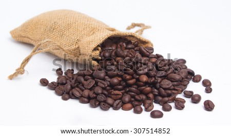 Coffee Bean with wooden spoon on white background - stock photo