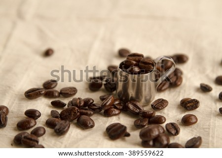 coffee beans and a little pot on the sackcloth.