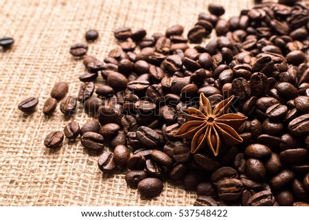 Coffee beans and badian on the sackcloth background