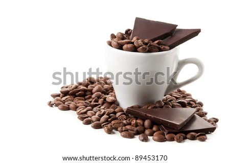 coffee beans and chocolate isolated on a white background - stock photo