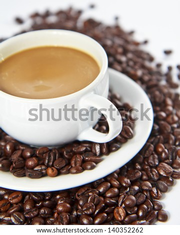 Coffee beans and coffee cup. - stock photo