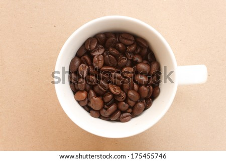 coffee beans and cup full of coffee