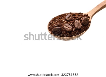 Coffee beans and ground coffee on wooden spoonisolated over white background - stock photo