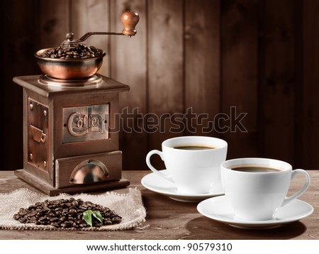 coffee beans and old coffee mill - stock photo