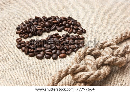 coffee beans and rope knot on sack