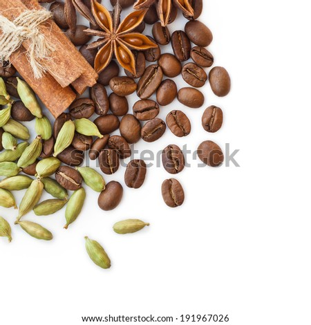 Coffee beans and spices on a white background - stock photo