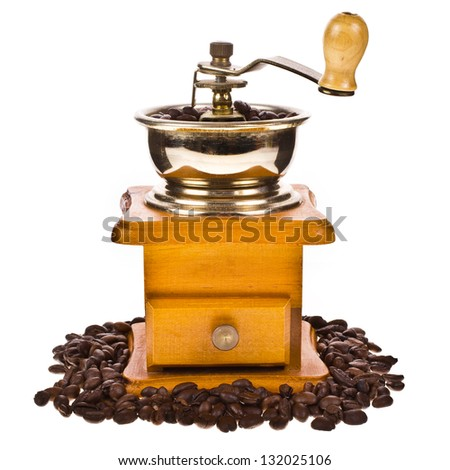 Coffee beans  and vintage coffee mill isolated on white background - stock photo