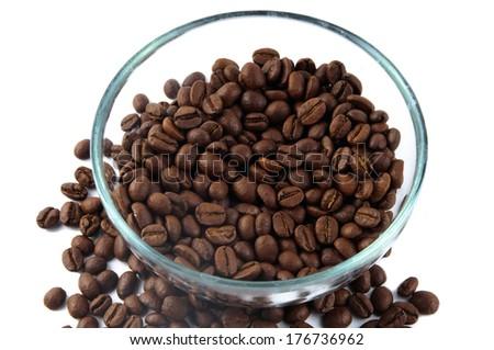 Coffee beans around glass jug - stock photo