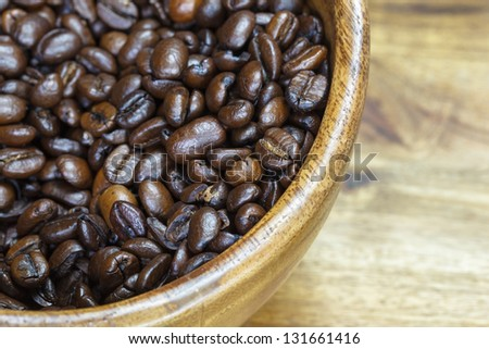 Coffee beans. Bowl of aromatic coffee,  close-up. with copy space - stock photo
