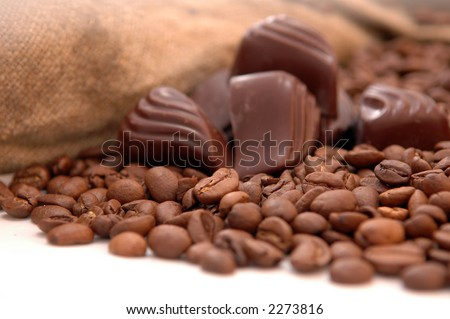 coffee beans, chocolate and old bag (shallow DOF, focus on coffee) - stock photo