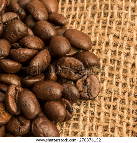 Coffee Beans Close-Up On Canvas Bag/ Coffee Beans. - stock photo
