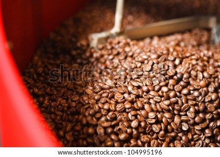 Coffee beans cooling down after roaster - stock photo