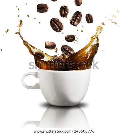 Coffee Beans Falling Into Glass of Hot Coffee Splash - stock photo