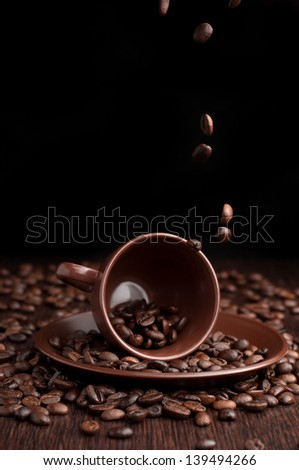 Coffee beans flow in a cup