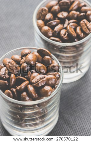 Coffee beans for espresso shot in a cafe or coffee shop. Photo in vintage color tone style.